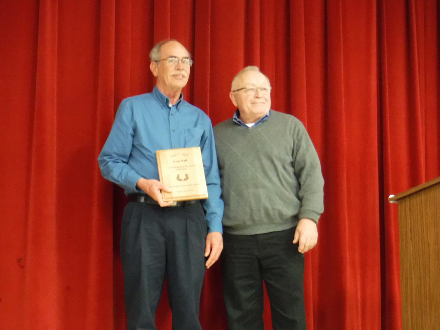 Greg Wall accepts the award for Outstanding Watershed Individual presented by John Linkes